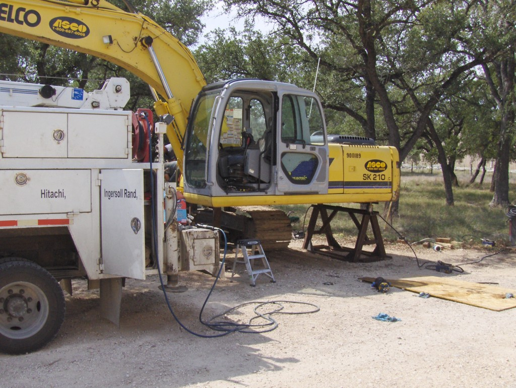 mechanic excavator cab removal and repair